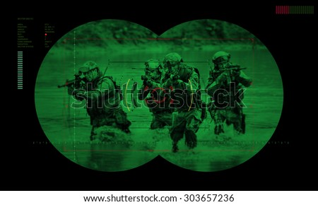 rangers team during night mission/operation hostage rescue.view through the night vision device  - stock photo