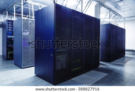 ranks modern supercomputers in the server room of datacenter - stock photo