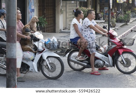 RANONG, THAILAND - JANUARY 2015: On the streets of the Thai town of Ranong is the easiest way to move around on the bike.