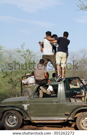 RANTHAMBORE, INDIA-JUNE 24: People eagerly waiting for tiger sighting in Safari jeep during game drive in Ranthambore National Park, Sawai Madhopur, India on June 24, 2015