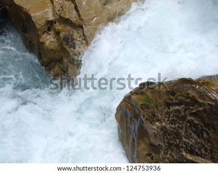Rapid foamy stream / Streams, rivers and river boulders - stock photo