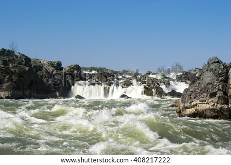 Rapid river and rocks background. Spring scene. Dangerous river. Nature movement, motion. River flow