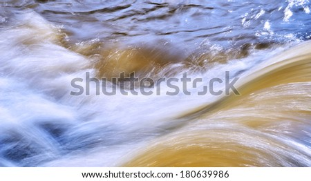 Rapids on a river - stock photo