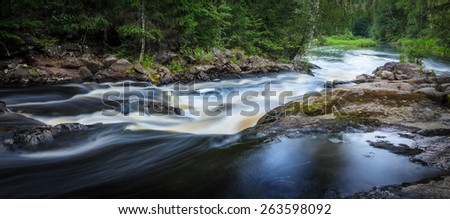 rapids on the river with stones and boulders - stock photo
