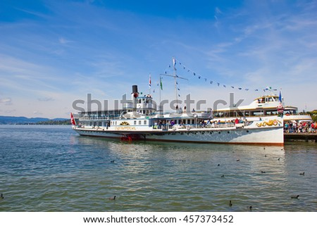 """RAPPERSWIL, SWITZERLAND - AUGUST 17, 2014: Historical steam boat """"Stadt Rapperswil"""" preparing for cruise on lake Zurich.Steamboat cruises on the lakes is popluar tourist attaraction of Switzerland - stock photo"""