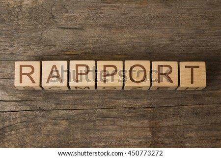 RAPPORT word on wooden cubes