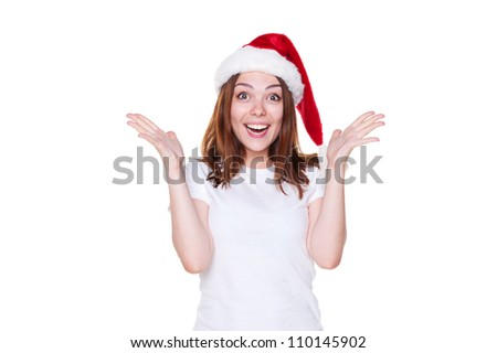 rapturous young woman in santa hat over white background - stock photo