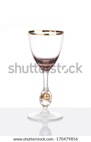 Rare antique wine glass with reflection, isolated on white - stock photo
