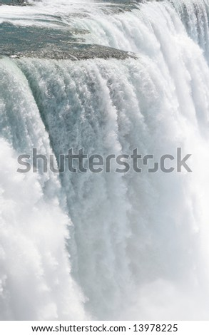 Rare close up detail of Niagara Falls (American side) shot from the Prospect Point, fast shutter speed to freeze the motion - stock photo