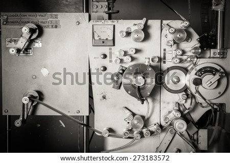 Rare industrial cinema 35 mm movie printer detail vintage black and white, analog optical process with rgb lamps and reels in post production factory - stock photo