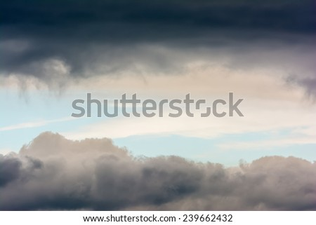 Rare Weather Phenomenon Of Horizontal Blue Sky Patch In Storm Clouds - stock photo