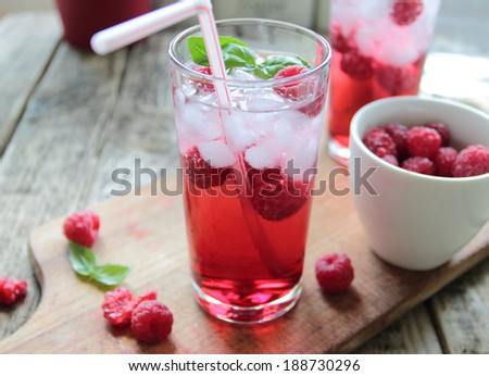 Rasberries juice with fresh fruits and ice - stock photo