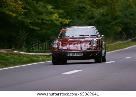 RASNOV, ROMANIA - OCT. 1: Ganescu Costin drives a PORSCHE 911 T car during Rally of Romania 2010 championship on October 1, 2010 in Rasnov, Romania.