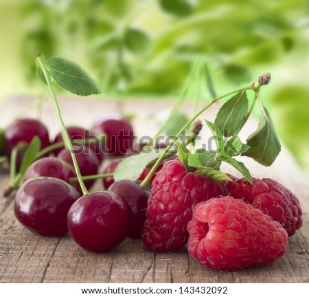 raspberries and cherries - stock photo
