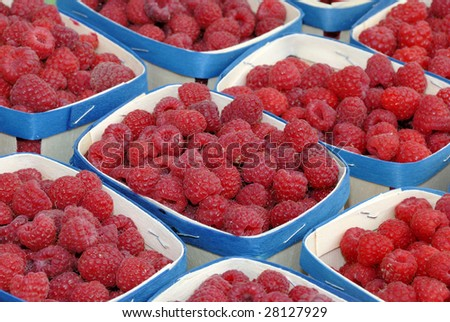 raspberries in containers on a French farmers market