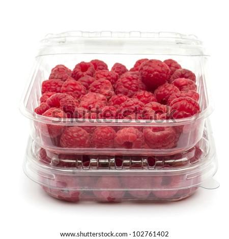 Raspberries in plastic box on white - stock photo