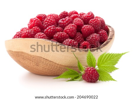 raspberries in wooden bowl isolated on white background cutout - stock photo