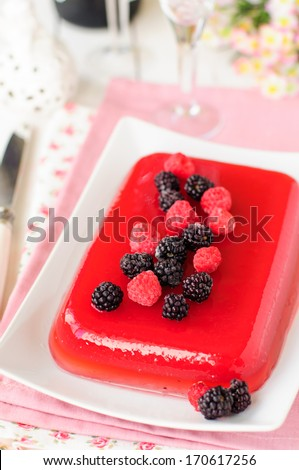 Raspberry and Champagne Jelly Garnished with Fresh Berries, selective focus on berries, copy space for your text - stock photo
