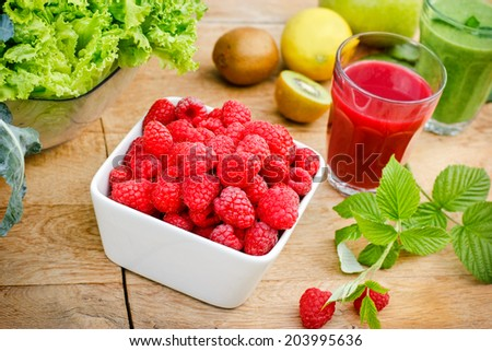 Raspberry and smoothie (juice) of raspberry and green smoothie - stock photo