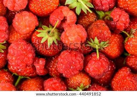 Raspberry And Strawberry Pile In Fruit Market