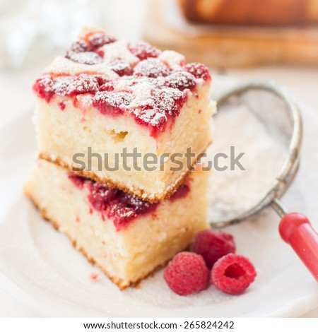 Raspberry and Yogurt Cake Dusted with Icing Sugar, square - stock photo
