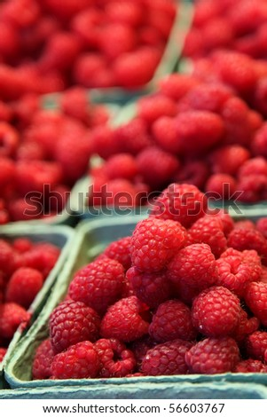 Raspberry basket pyramids at a farmers market - stock photo