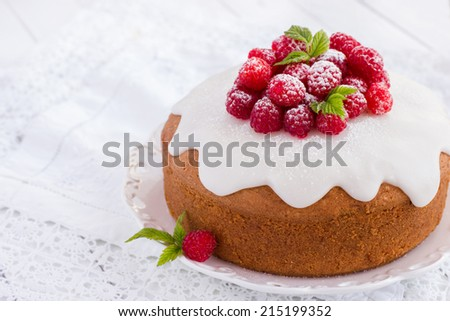 raspberry cake with sugar icing on a white background - stock photo