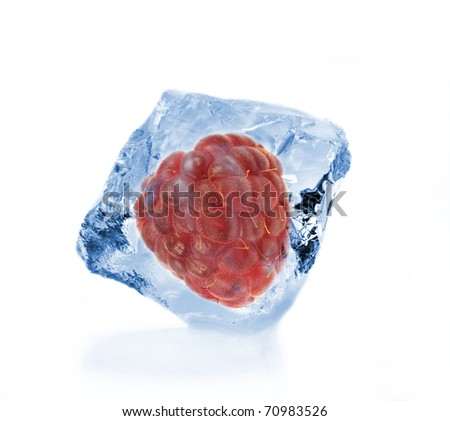 Raspberry  frozen in ice cube isolated on white background
