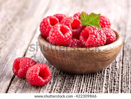 Raspberry on a wooden board