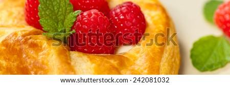 Raspberry pastries. Panoramic image. Selective focus. - stock photo