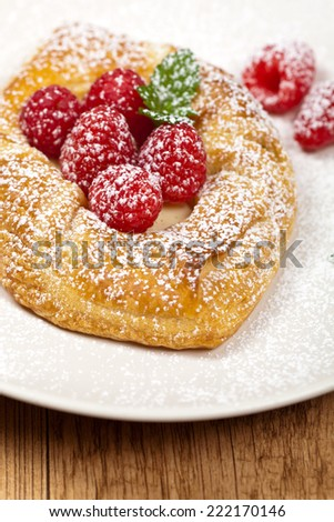 Raspberry pastries with powdered sugar. Selective focus. - stock photo