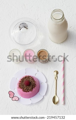 Raspberry Pudding and Milk Shots - stock photo
