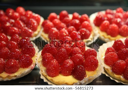 Raspberry tarts at a dessert store - stock photo