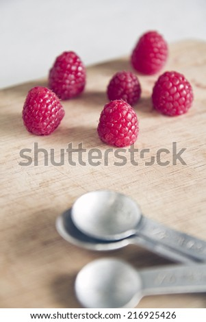 Raspberry with measure spoon, cooking - stock photo