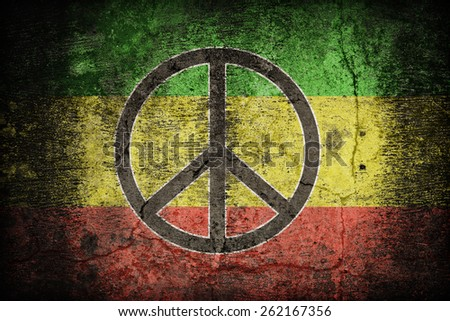 Rasta flag pattern with a peace on dirty old concrete wall texture ,retro vintage style