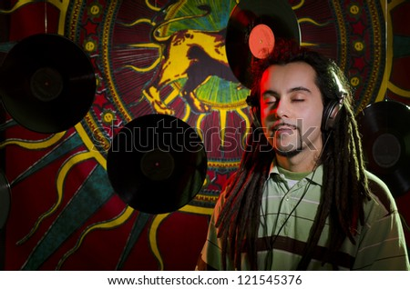 Rastaman listen the playlist before the concert - stock photo
