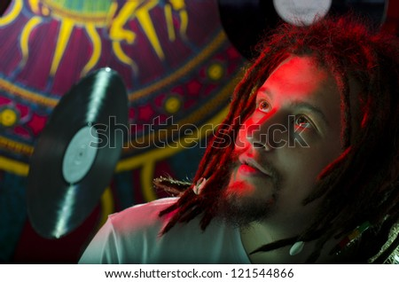 Rastaman sitting on the stage before the concert - stock photo
