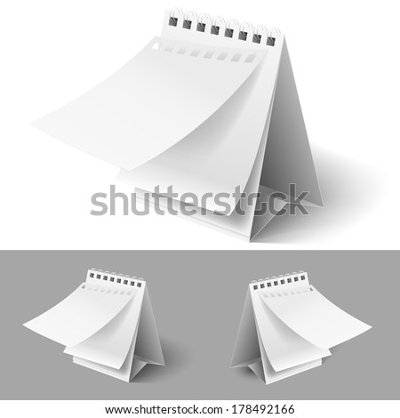 Raster version. Blank table flip calendars with tear off first page on white and grey backgrounds  - stock photo
