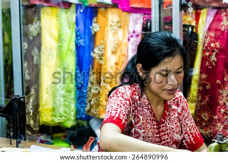 RATANAKIRI PROVINCE, CAMBODIA - SEPTEMBER 20: Unidentified seamstress in the sewing studio in Ratanakiri Province, Cambodia on Sep 20, 2011.