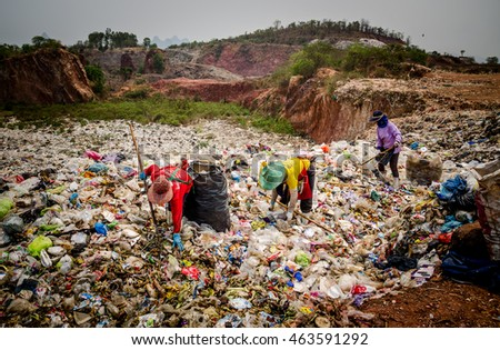 RATCHABURI PROVINCE, THAILAND-MARCH 18: People working in Municipal waste disposal open dump process.  Dump site at Ratchaburi Province on MARCH 18 , 2016 in RATCHABURI PROVINCE THAILAND