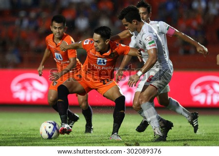 RATCHABURI THAILAND-AUGUST1:Adisak Srikumpang(L) of Ratchaburi F.C. in action during Thai Premier League between Ratchaburi F.C.and Bangkok UTD F.C. at Ratchaburi Stadium on August1,2015 in Thailand - stock photo