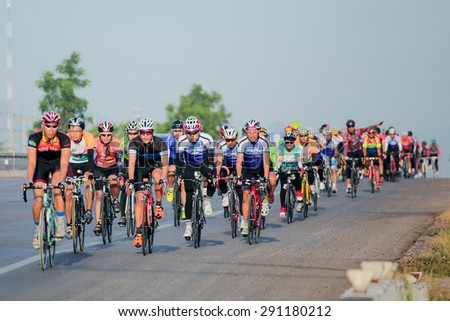 RATCHABURI,THAILAND - DECEMBER 24, 2015: Cyclists from different teams competing. In the Thailand championship.  - stock photo