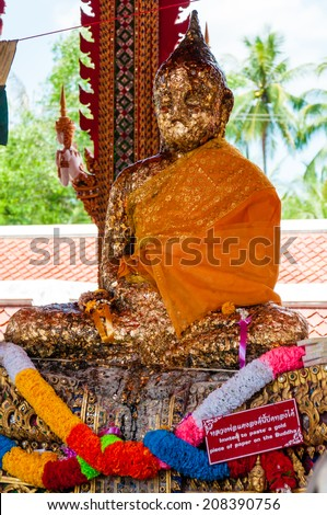Ratchaburi, Thailand - May 24, 2014: Shrine in buddhist temple at Damnoen Saduak Floating Market, Thailand.Buddhism is Thai primary religion with more than 90% of the population being Buddhist.
