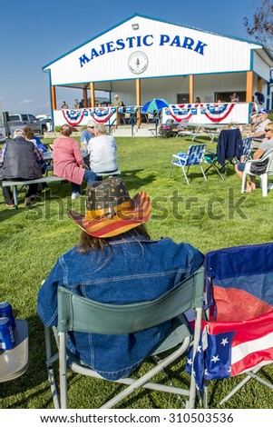 Rathdrum, Idaho USA - August 15, 2015. People in the small rural park to enjoy the Taste of Rathdrum events in north Idaho USA August 15, 2015. - stock photo