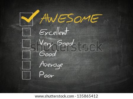 Rating / assessment checkbox concept on blackboard background - stock photo