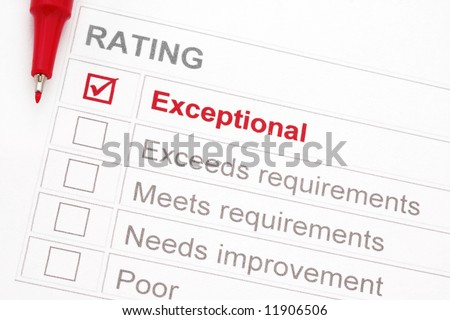 "Rating marked ""exceptional"", with red pen.  Could be a customer service rating, performance appraisal, educational assessment, etc. - stock photo"