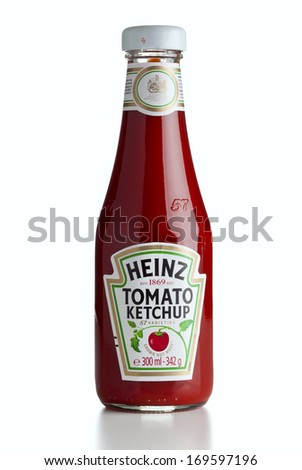 Ratingen, Germany - July13, 2011: A bottle of Heinz Ketchup isolated on white background. - stock photo