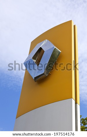 Ratingen, Germany - May 29, 2011: Signage at Renault car dealer's building. Renault S.A. is a french car manufacturer producing cars, vans, buses and trucks, headquartered in Boulogne-Billancourt.  - stock photo