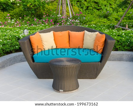 Rattan armchair furniture in garden. - stock photo