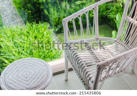 rattan chair with garden view from top - stock photo
